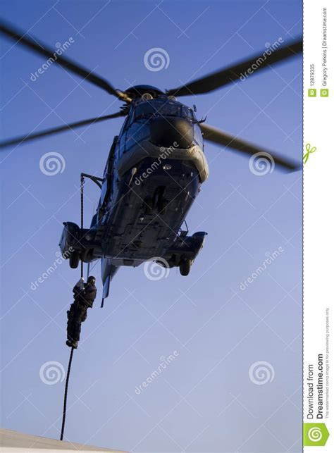 SWAT Agent Descending From A Helicopter Royalty Free Stock