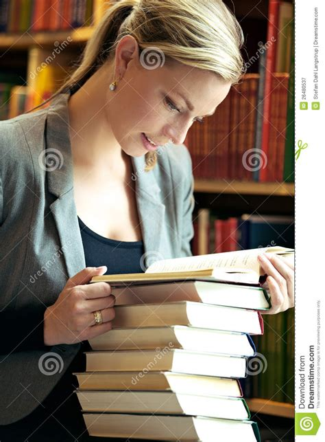 Woman Doing Research In Library Royalty Free Stock
